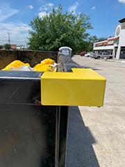 Tarp Saver on dumpster